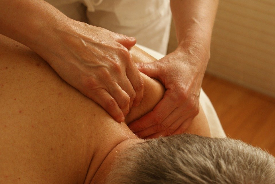 A patient with shoulder pain undergoing treatment